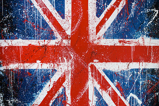 Painted concrete wall with graffiti of British flag stock photo