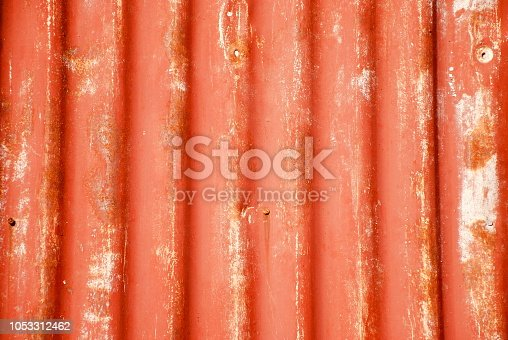 Painted Corrugated Iron Sheet with Nails and Rust. This is a typical building element in New Zealand Architecture, both as a Rural Shed and Backcountry Hut; to Modern Kiwiana Design.