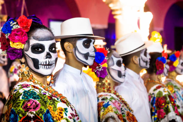 Painted dancers with Catrina skulls for dia de los muertos after the show on Palacio Municipal, Merida, Yucatan, Mexico stock photo