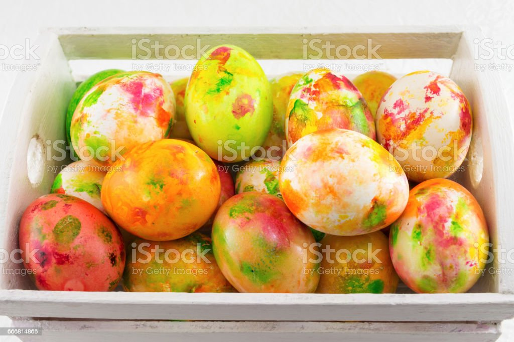 Painted Easter eggs in wooden box stock photo