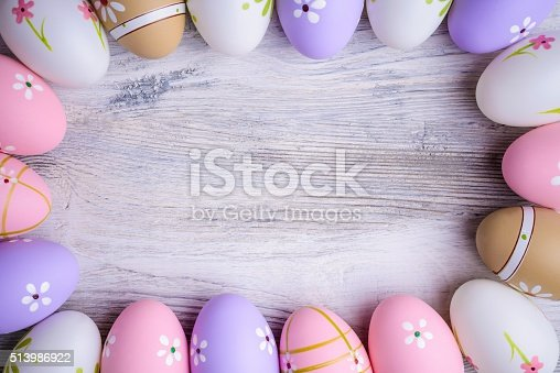 1136239089 istock photo Painted  Easter eggs with copy space on grey wooden background 513986922