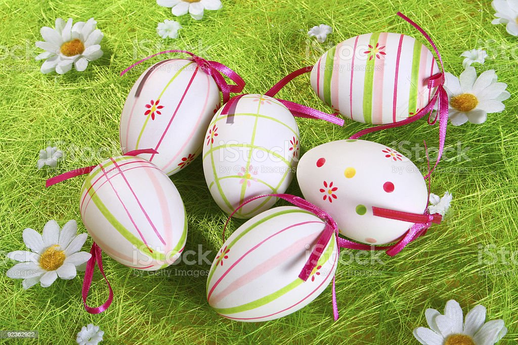 Painted eggs on green background royalty-free stock photo