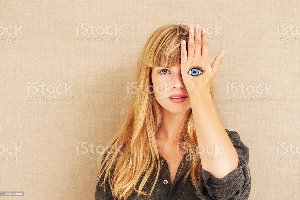 Painted eye on beautiful blond stock photo