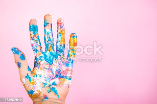 istock Painted hand on background. 1175602849