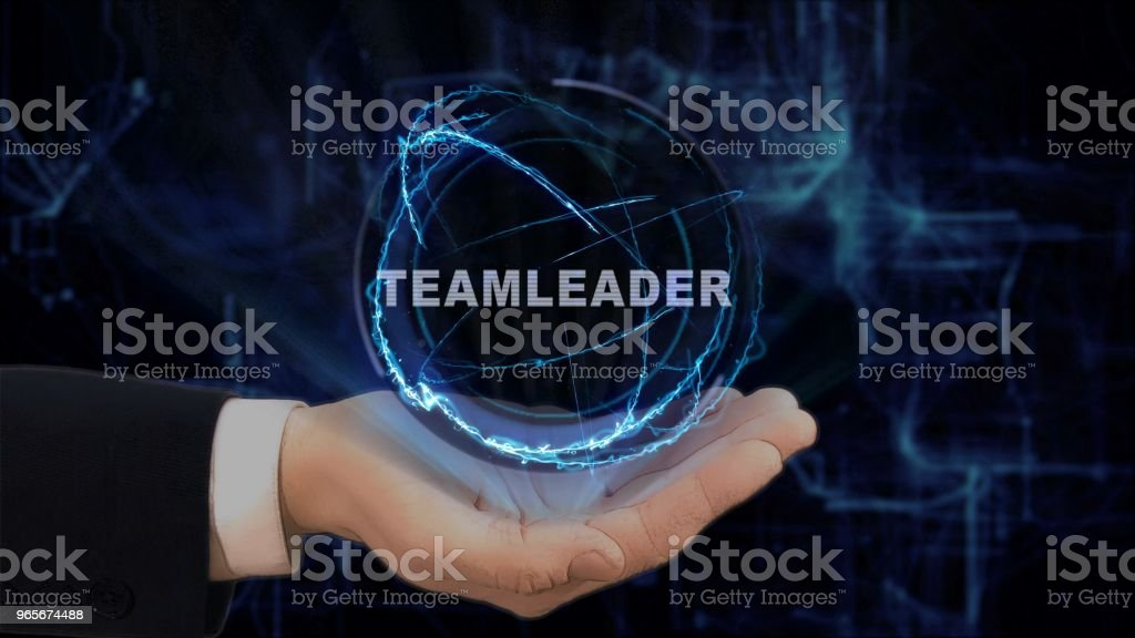 Painted hand shows concept hologram Teamleader on his hand stock photo