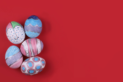 painted handmade easter eggs on a red background