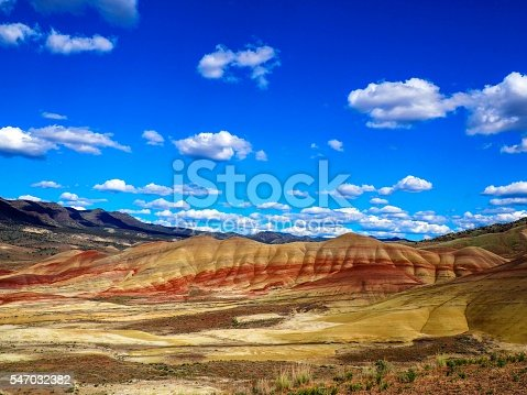 The colorful painted hills of the John Day Fossil Beds National Monument on a bright sunny day