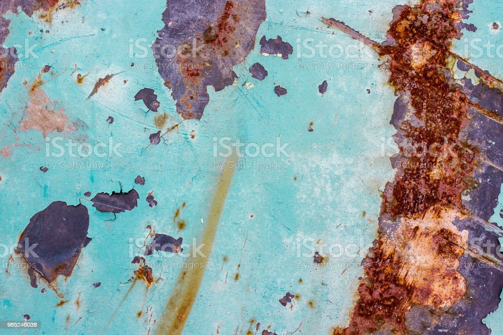 Painted iron background with a large rusty spot and metal corrosion. zbiór zdjęć royalty-free
