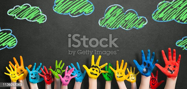 istock painted kids hands in front of a blackboard 1126017063