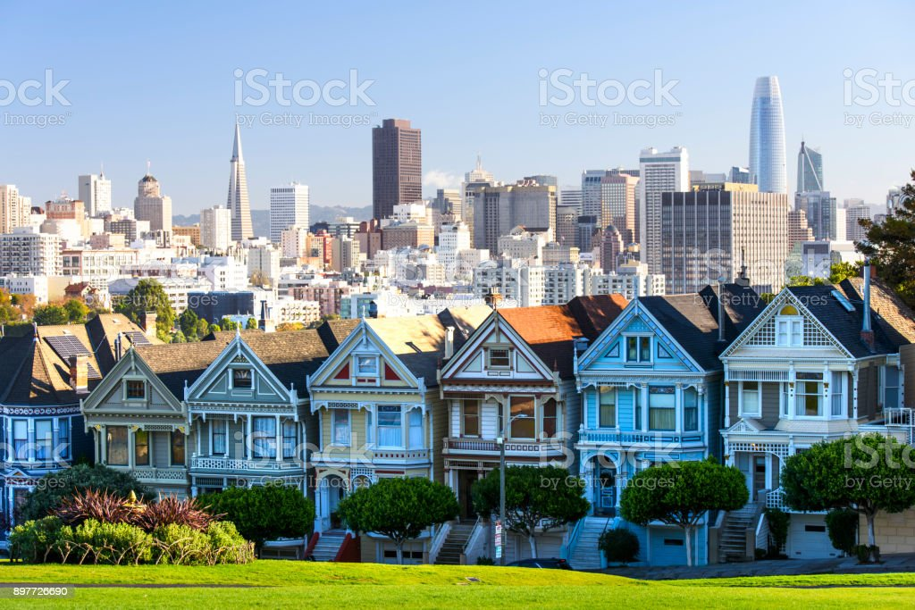 Painted Ladies Houses in San Francisco in evening hour Panorama stock photo