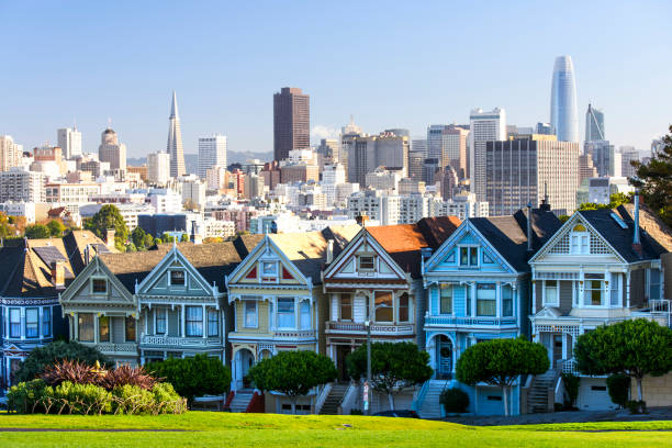 Painted Ladies Houses in San Francisco in evening hour Panorama Famous painted ladies after sunset san francisco california stock pictures, royalty-free photos & images