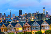 Famous painted ladies after sunset with San Francisco downtown in the background