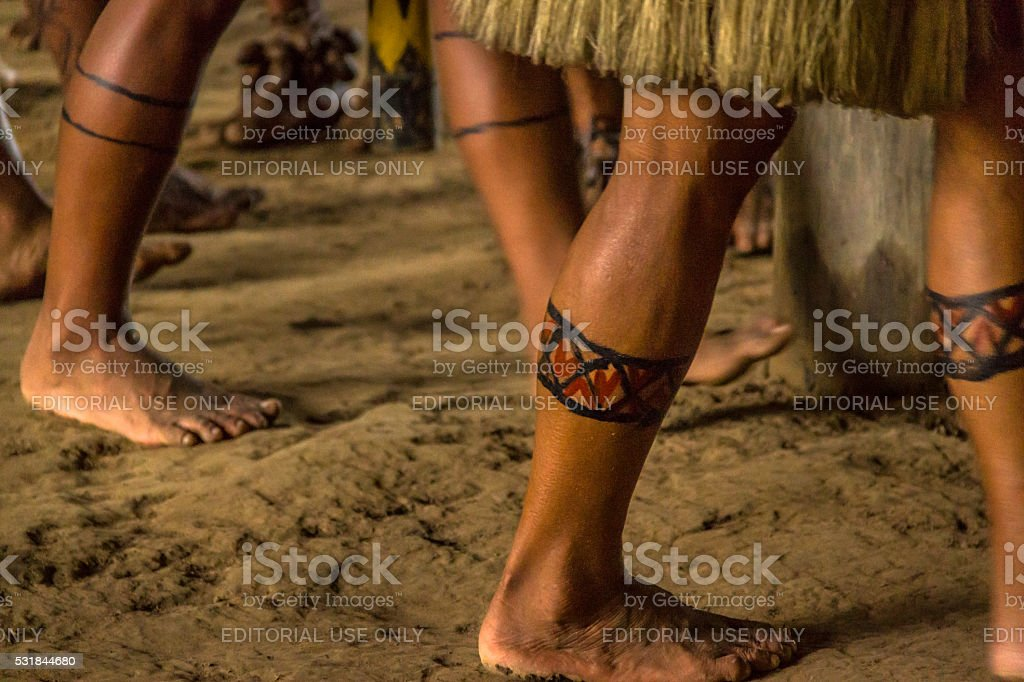 Painted legs of Indigenous stock photo