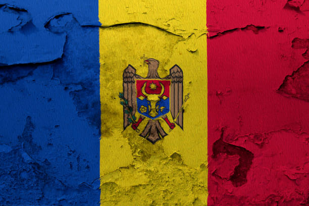 painted national flag of moldova on a concrete wall - moldova stock pictures, royalty-free photos & images