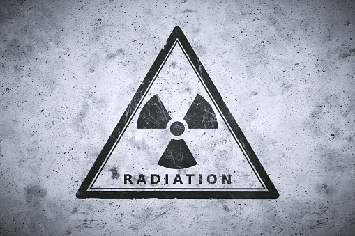 Painted Nuclear Warning Sign Stock Photo - Download Image