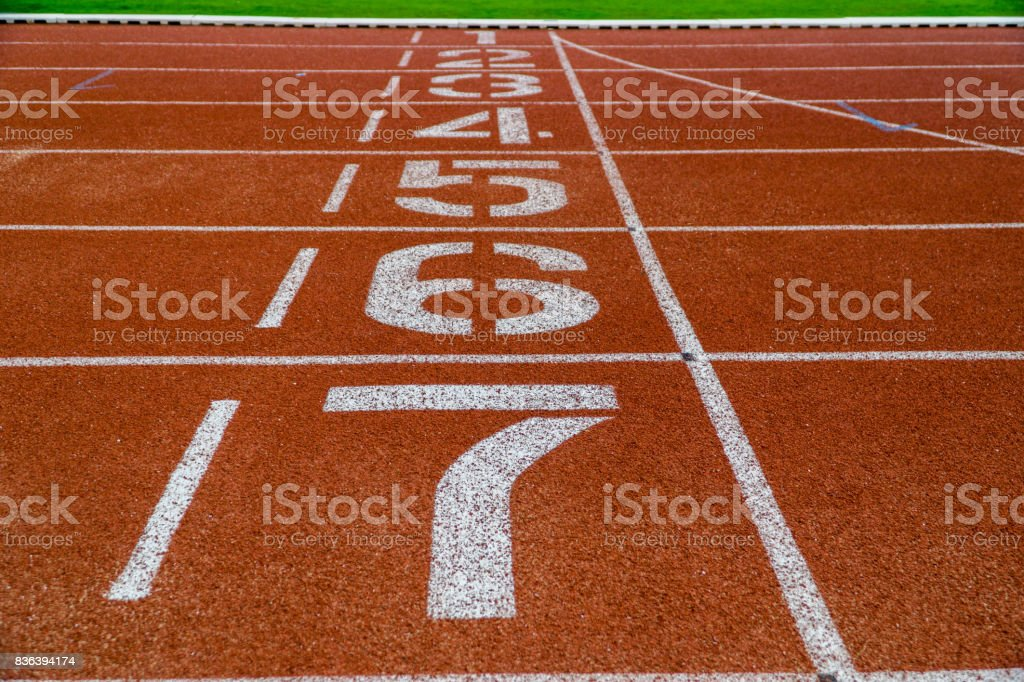 Painted numbers on running track stock photo