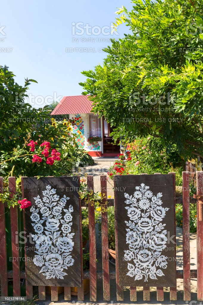 Painted old wooden fence decorated with a hand painted floral...