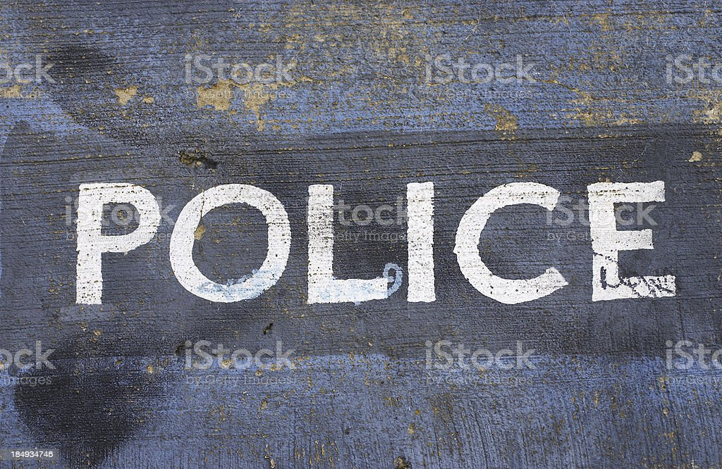 Police written in white capital letters on blue stock photo