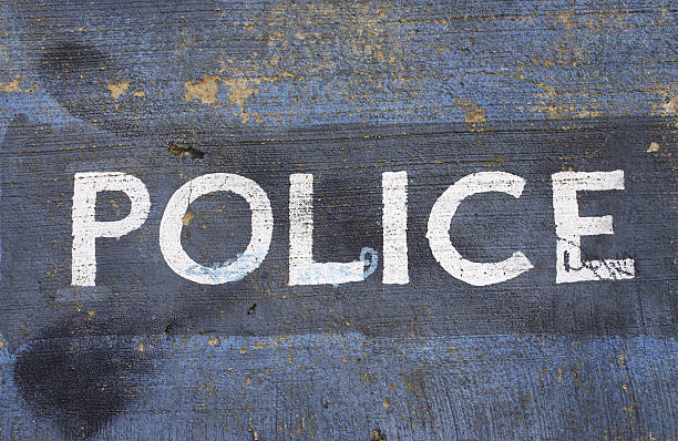 police written in white capital letters on blue - whiteway graffiti stock photos and pictures