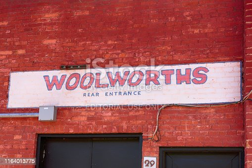 Painted on brick - Woolworths store sign seen in Bisbee, AZ