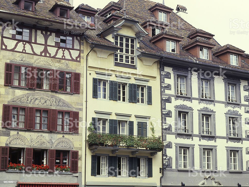 Painted ornate buildings in Luzern Switzerland royalty-free stock photo
