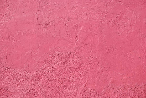 painted pink wall texture - mexico stock photos and pictures