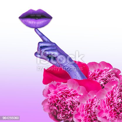 1014178164 istock photo Painted purple hand coming out of flowers and pointing to violet lips. 964255060