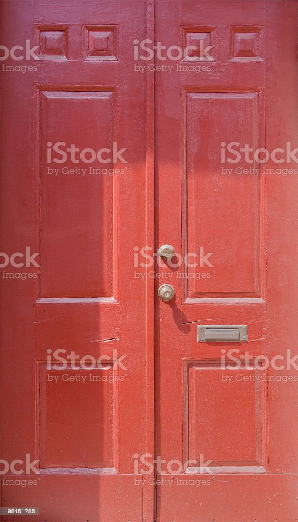 Painted red doors with mail slot royalty-free stock photo