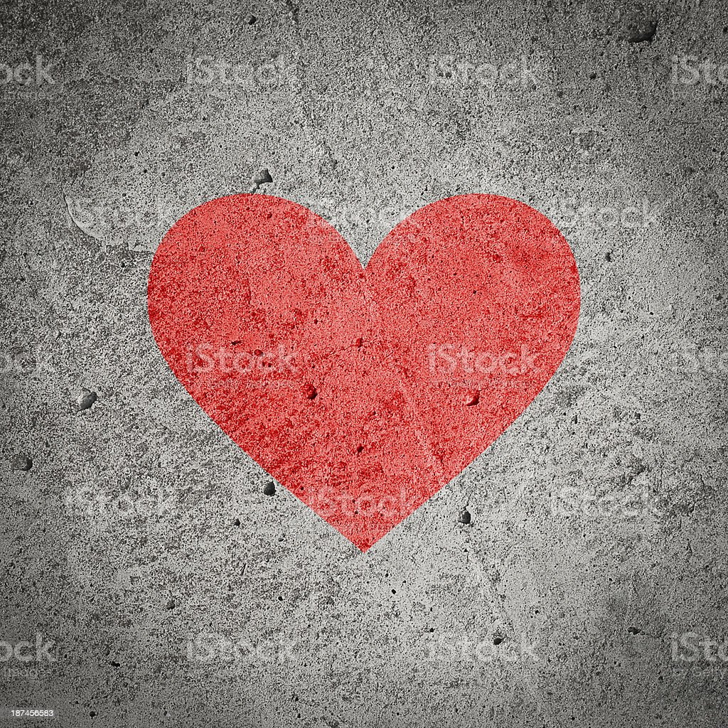 Painted red heart on dark grey grunge concrete, cement wall stock photo
