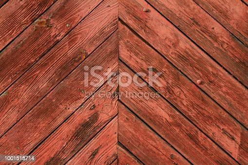 painted in red, weathered wooden sun, solid and strong door