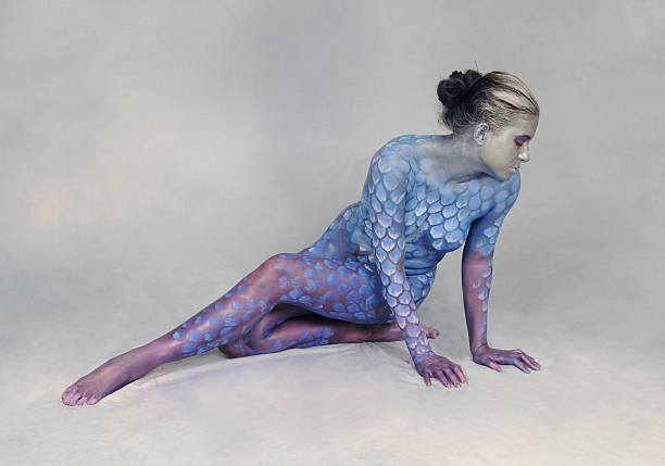 painted scales - naked women with animals stock photos and pictures