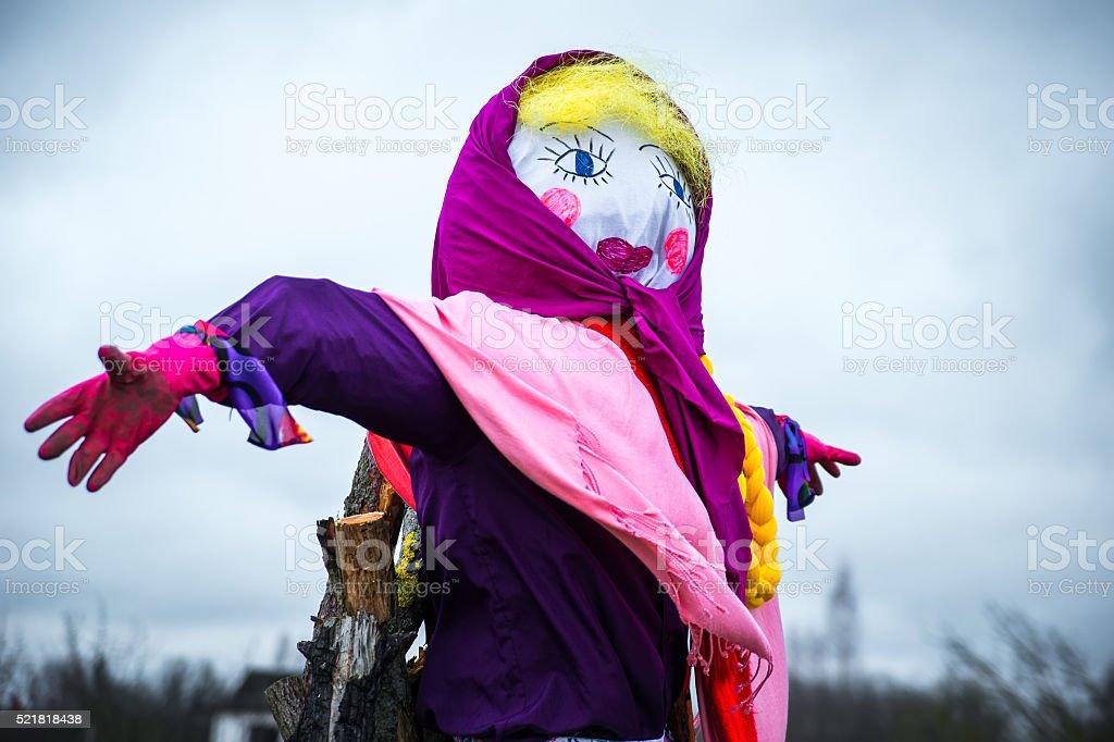 Painted scarecrow stock photo