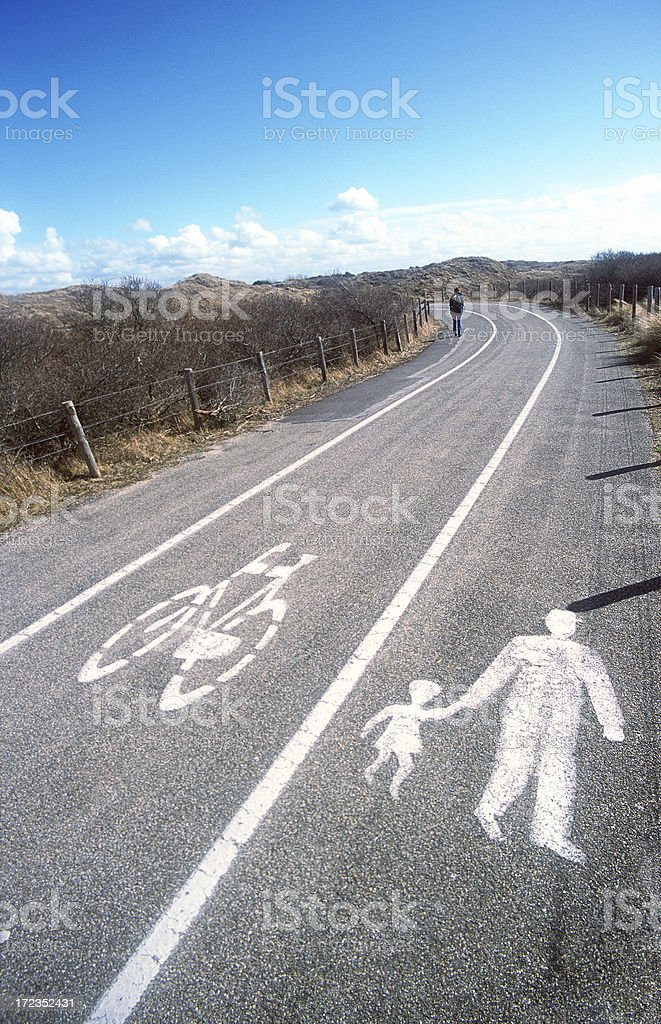 Painted sign of man and child on the road royalty-free stock photo