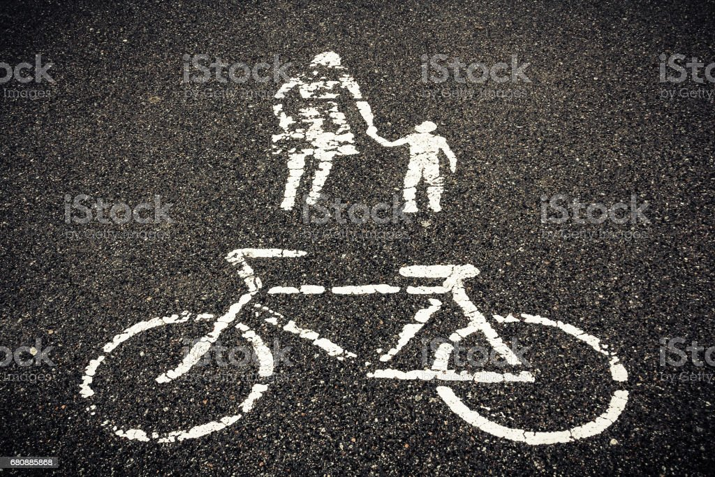painted sign on asphalt, bicycle woman with child royalty-free stock photo