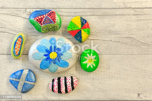 Painted stones on a shabby style board