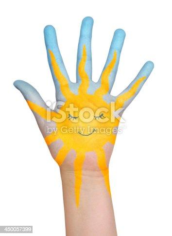 istock Painted sun on hand. 450057399