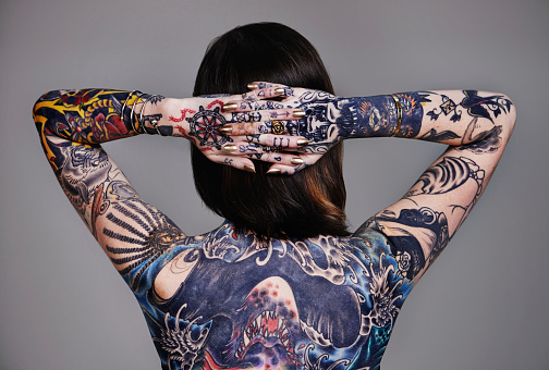 A cropped shot of a tattooed young womanhttp://195.154.178.81/DATA/i_collage/pi/shoots/784105.jpg