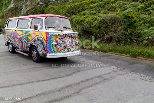 San Francisco, United States: May 12, 2019: Painted Volkswagen van in vivid colors driving in the street in the city of San Francisco
