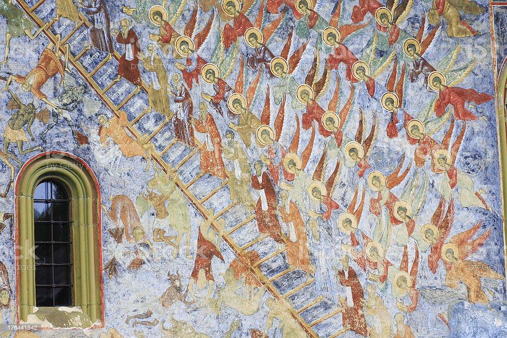 Painted wall at Sucevita monastery in Bucovina royalty-free stock photo