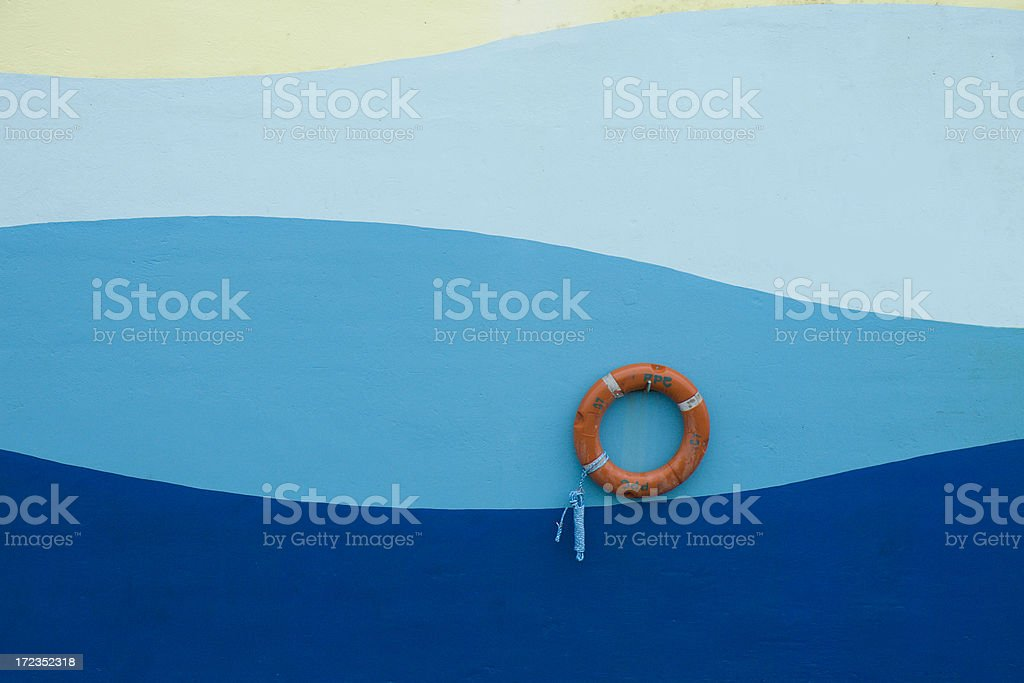 Painted Wall with Life Ring royalty-free stock photo