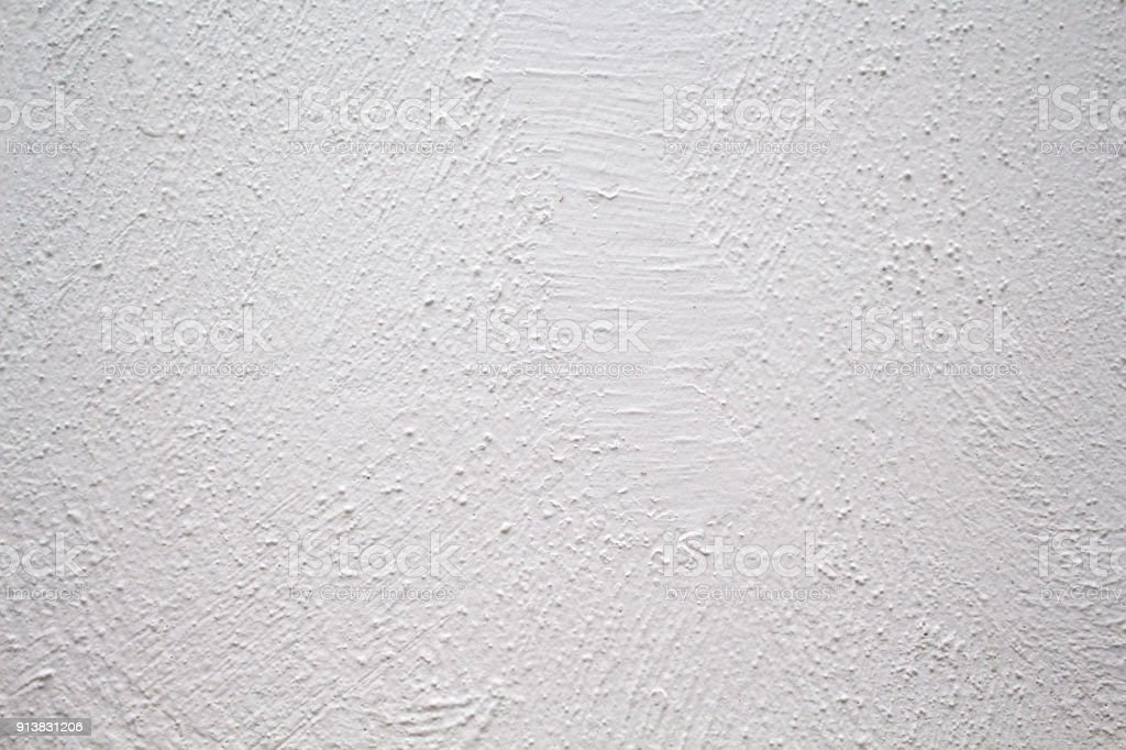 Painted wall with rough texture closeup photo. White plaster with brushed texture. stock photo