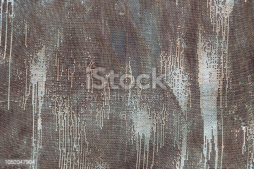 636061068 istock photo Painted white metal grid background or texture. 1052047904