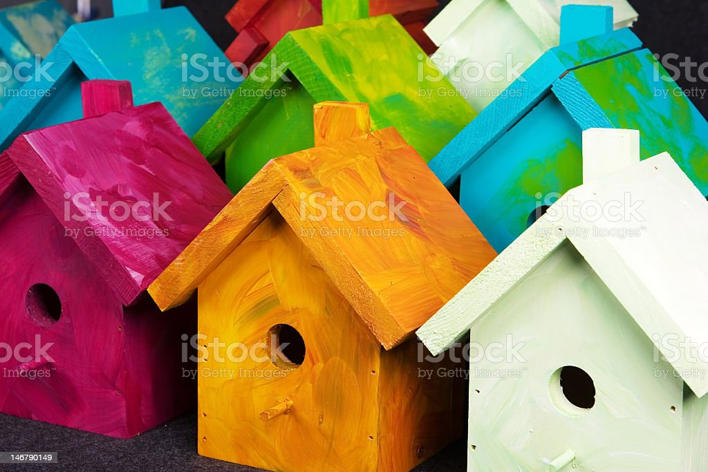 Painted wooden bird houses in a line stock photo