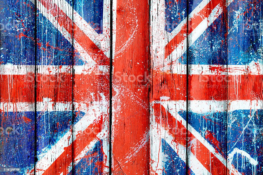 Painted wooden wall or fence with graffiti of British flag stock photo