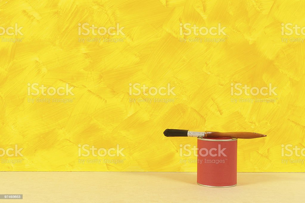 Painted yellow wall with red paint tin royalty-free stock photo
