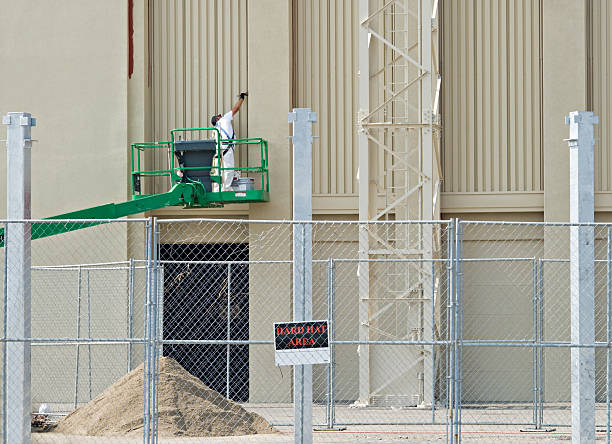 Painter at Construction Site stock photo