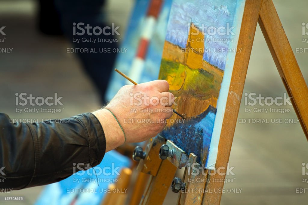 Painter at work on street royalty-free stock photo