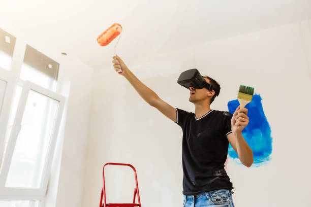 maler-auftragnehmer mit virtual reality brille - pflasterbau stock-fotos und bilder