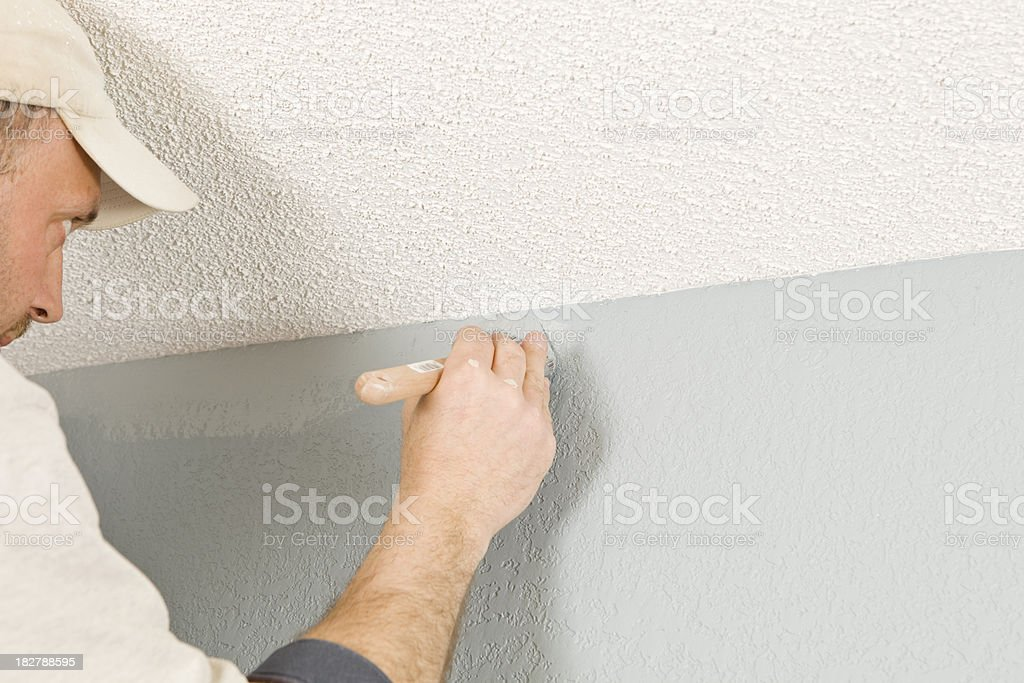 Painter Cutting in Wall to Ceiling royalty-free stock photo