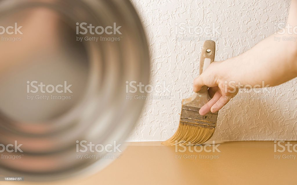 Painter Cutting In Wall to Knockdown Ceiling royalty-free stock photo